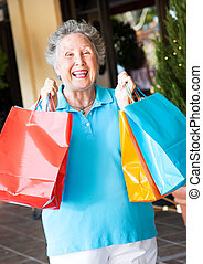 Senior Woman Shopper - Senior on a shopping trip, excited...
