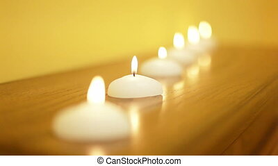 Candles stand in a row.