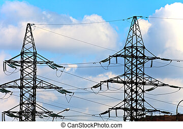 electricity towers - Two high voltage electricity towers on...