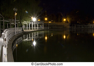 Lake view of a city at night - a Lake view of a city at...