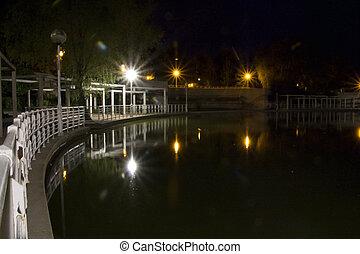 Lake view of a city at night - a Lake view of a city at...