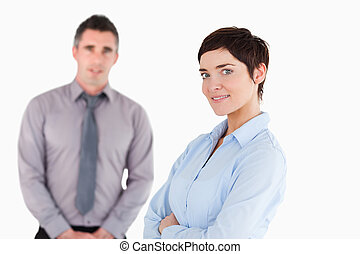 Close up of office workers posing against a white background