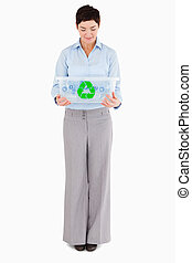 Businesswoman looking at a recycling box