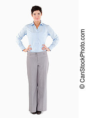 Serious businesswoman standing up against a white background