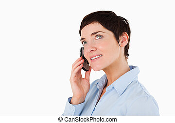 Close up of a serious woman making a phone call