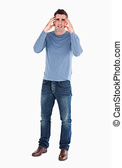 Anxious man posing against a white background