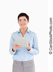 Portrait of a businesswoman holding a document against a...