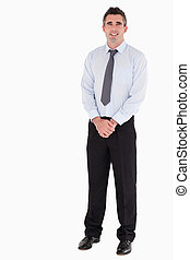 Businessman standing up against a white background