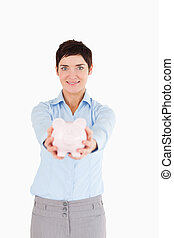 Office worker holding a piggy bank