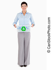 Businesswoman holding a recycling box