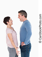 Couple having an argument against a white background