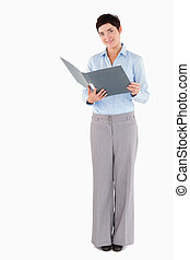 Woman holding a binder against a white background