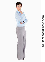 Businesswoman standing up against a white background