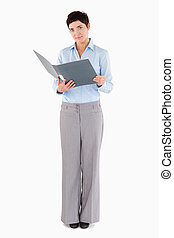 Businesswoman holding a binder against a white background