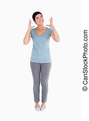 Upset woman standing up against a white background