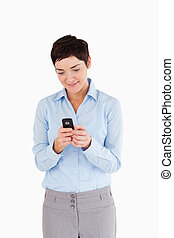 Portrait of a businesswoman sending text messages