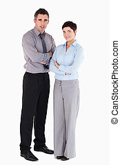 Coworkers standing up against a white background