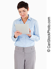 Portrait of a businesswoman looking at a document against a...