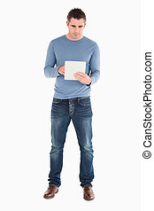 Man using a tablet computer against a white background