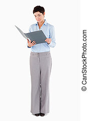 Woman looking at a binder against a white background