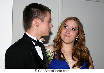 Prom Girl Smirking at Date - Teenage girl smirking at her...
