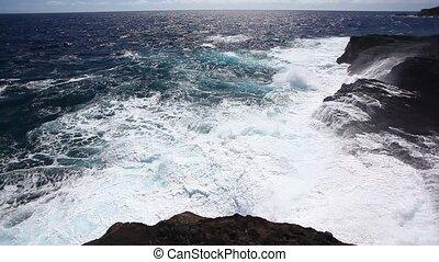 Rocky Shore - Ocean waves crash over a rocky shore