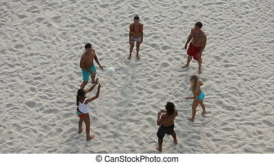 Volleyball - A group of young people playing volleyball on...