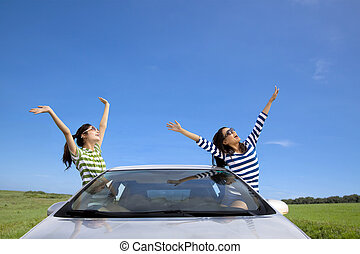 two happy woman  in the car and enjoy vacation