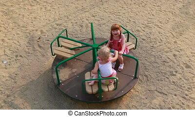 Girls on carousel - Two little girls on carousel