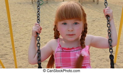 Chain swings - Little girl on chain swings