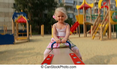 Up and down - Little girl on swings