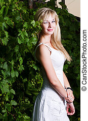 Young attractive blond girl posing outdoors