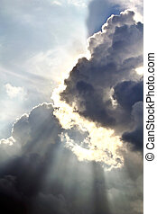 Sun rays through clouds - Spectacular sun rays emerging...