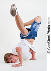 Teen b-boy standing on his head in freeze - Teenager bboy...