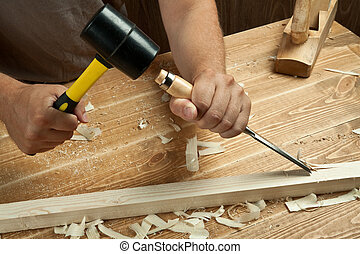 Wood working - Wood workshop. Carpenter working with chisel.