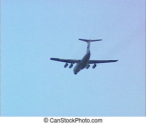 russian airplane il-76 flying away in blue sky