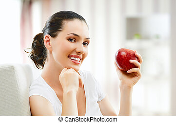 red apple - A beautiful girl eating apple