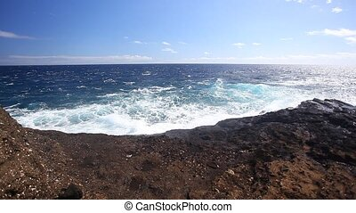Rocky Shore  - Ocean waves crash over a rocky shore.
