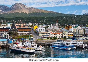 Ushuaia Harbor, Tierra del Fuego - Boats line the harbor in...
