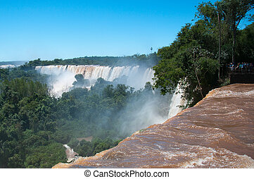 Iguazzu Falls. South America - Tourists view the famous...
