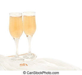 Romantic wedding - Champagne glasses with rings and pearls...