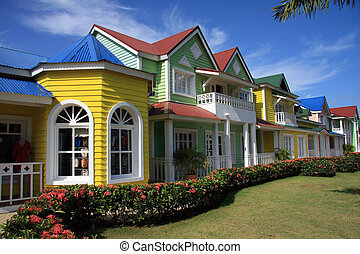 Brightly painted row of shops - Brightly painted row of...