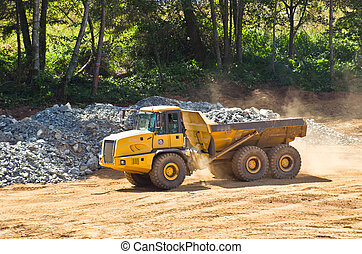 heavy duty dump truck with rock box hauling crushed rock