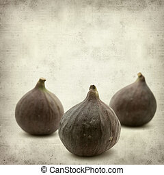 textured old paper background with ripe purple bursa figs...
