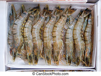 Raw jumbo tiger prawns at market - A box of market fresh raw...