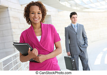 African Business Woman at Office - A handsome african...