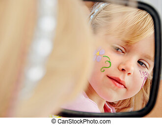 girl looking in mirror - Little blond girl looking in a...