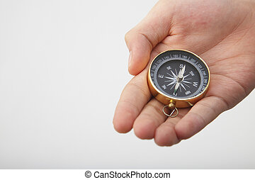 compass - hand show a compass on the plain background