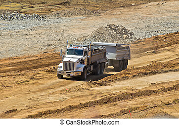 dump truck leaving work site