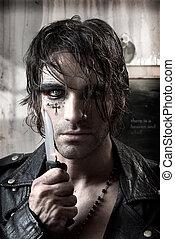 Dangerous man - Sexy portrait of a dangerous man holding...